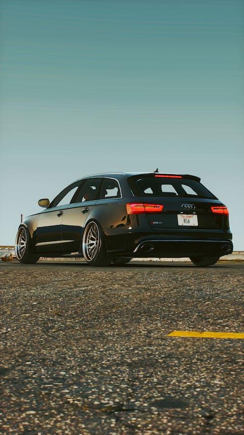 Black Audi on Gray Asphalt Road