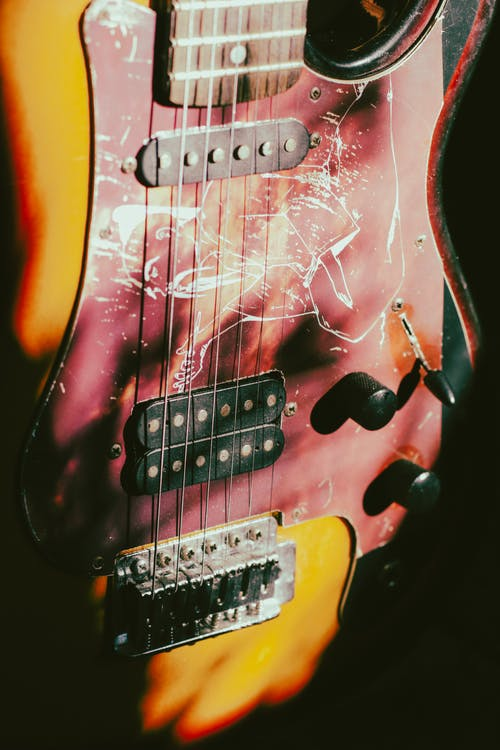Close-Up Photo of a Red Electric Guitar