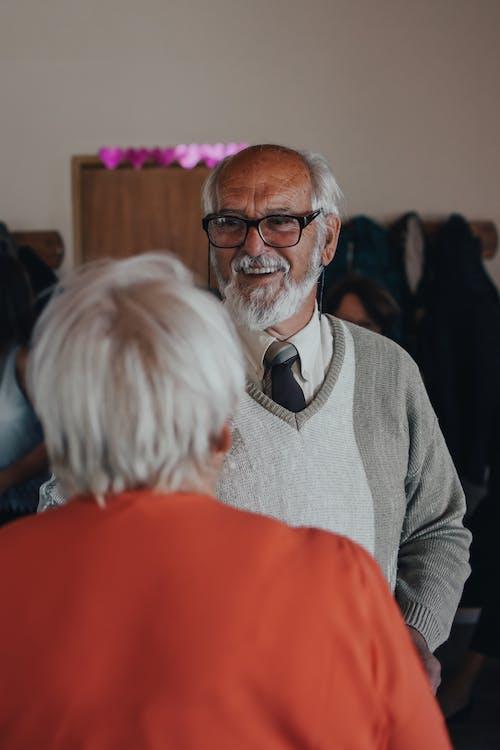 Elderly Man in Gray Sweater Smiling