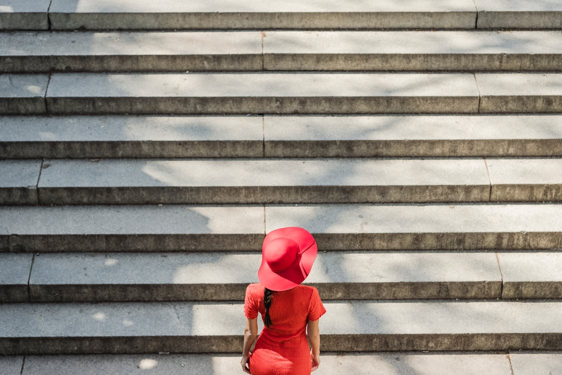 Woman in Red Dress Climbing the Stairs