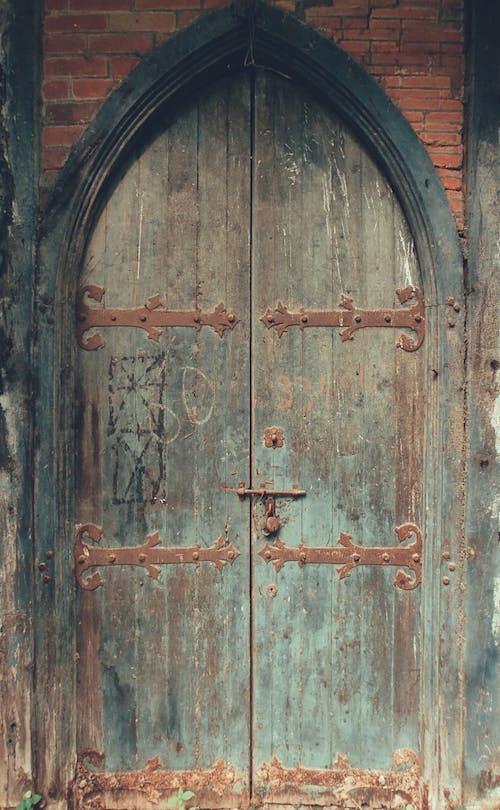 Brown Wooden Arched Door