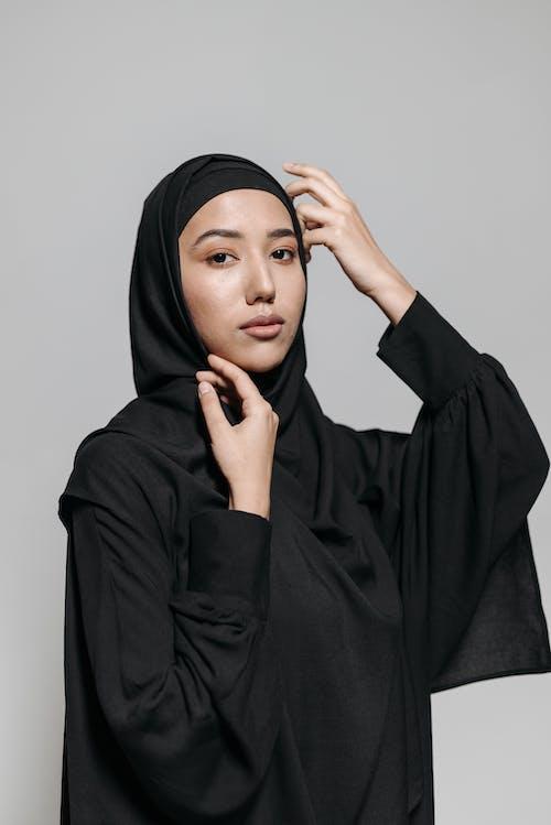 Woman in Black Hijab and Black Long Sleeve Shirt