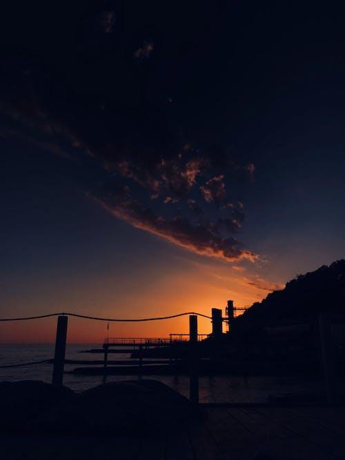 Free stock photo of backlit, beach, bridge
