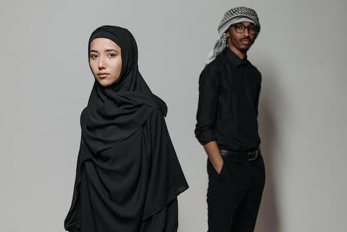 2 Women in Black Hijab Standing