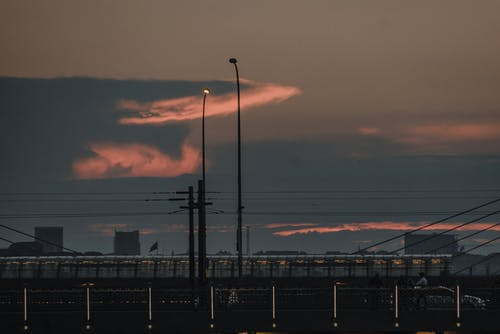 Silhouette of Street Lights during Sunset