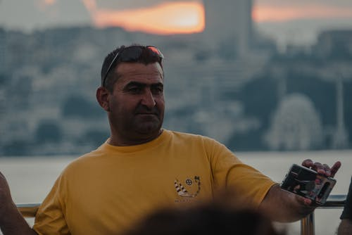 Man in Yellow Crew Neck T-shirt Wearing Black Sunglasses