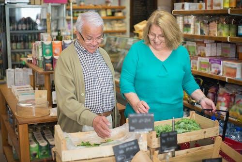 Elderly Couple Buying Groceries