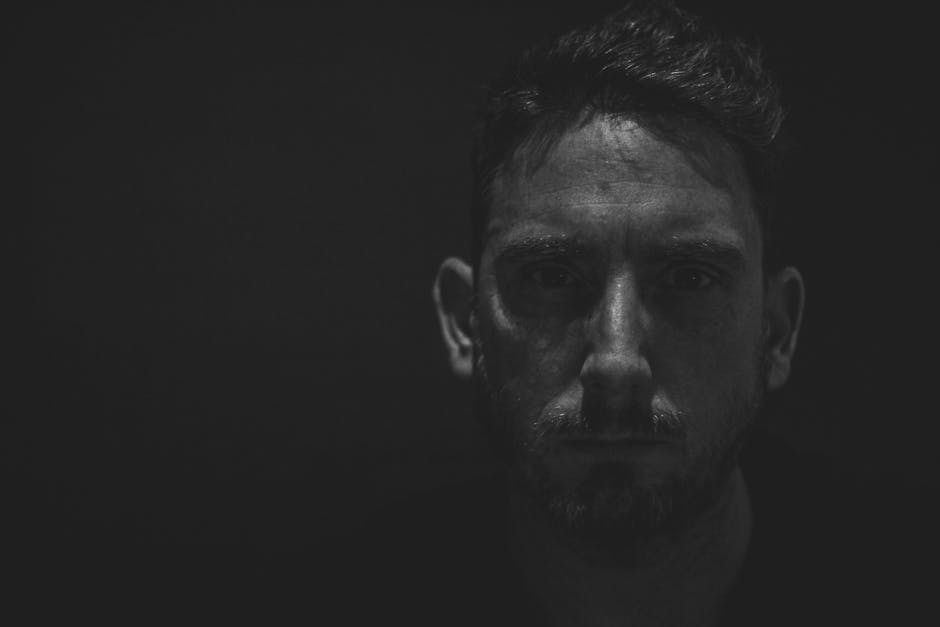 Monochrome Photography of a Man's Face