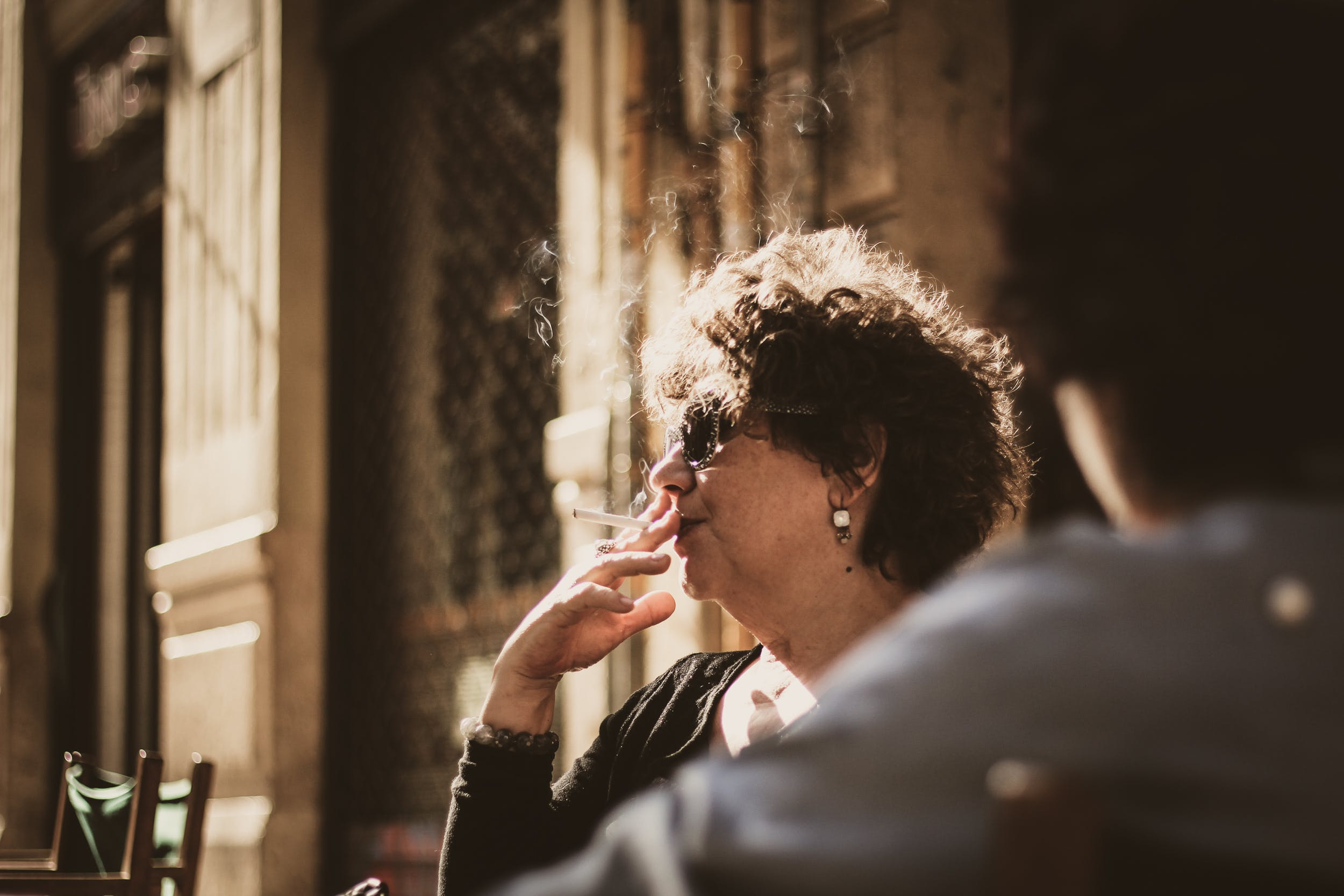 Photography of a Woman Smoking Cigarette