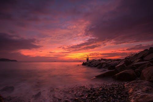 Photos gratuites de accéléré, bord de mer, cailloux, coucher de soleil
