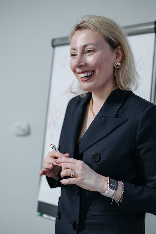Woman in Black Blazer Smiling