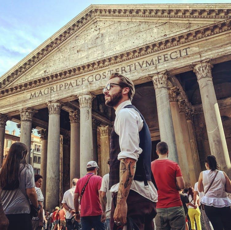 Man in Blue Waistcoat and White Dress Shirt Standing Near Pantheon