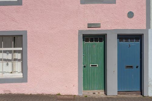Blue Wooden Door on Pink Concrete Wall