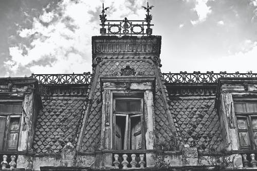 Grayscale Photo of a Derelict Building