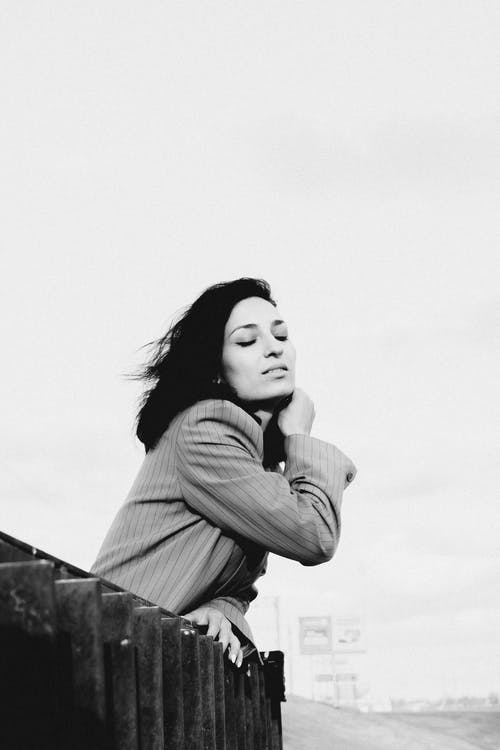 Grayscale Photo of Woman in Long Sleeve Shirt