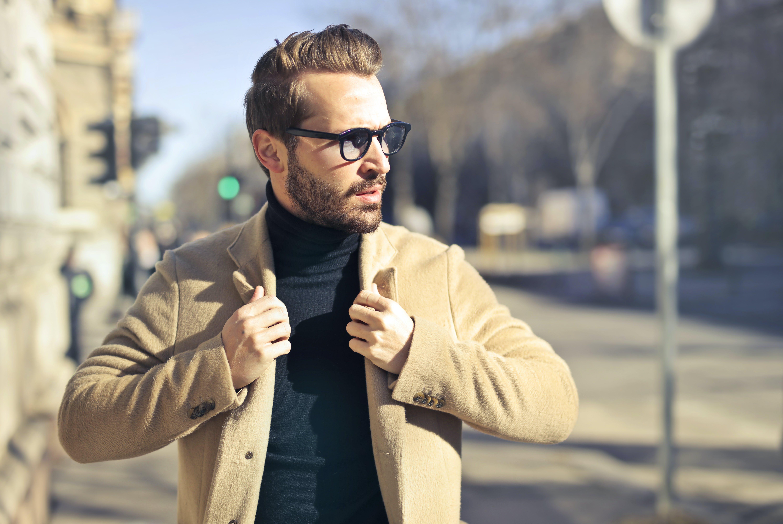 Man Wearing Eyeglasses and Brown Jacket