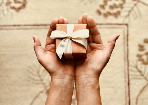 Inspiring and beautiful gift photos pexels free stock photos persons holds brown gift box negle Images