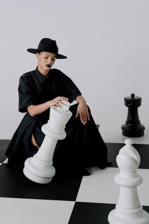 Man in Black Academic Dress and Black Hat