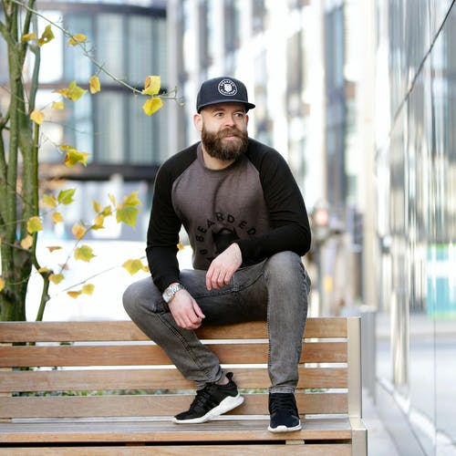 Free stock photo of bearded man, park bench, wooden bench