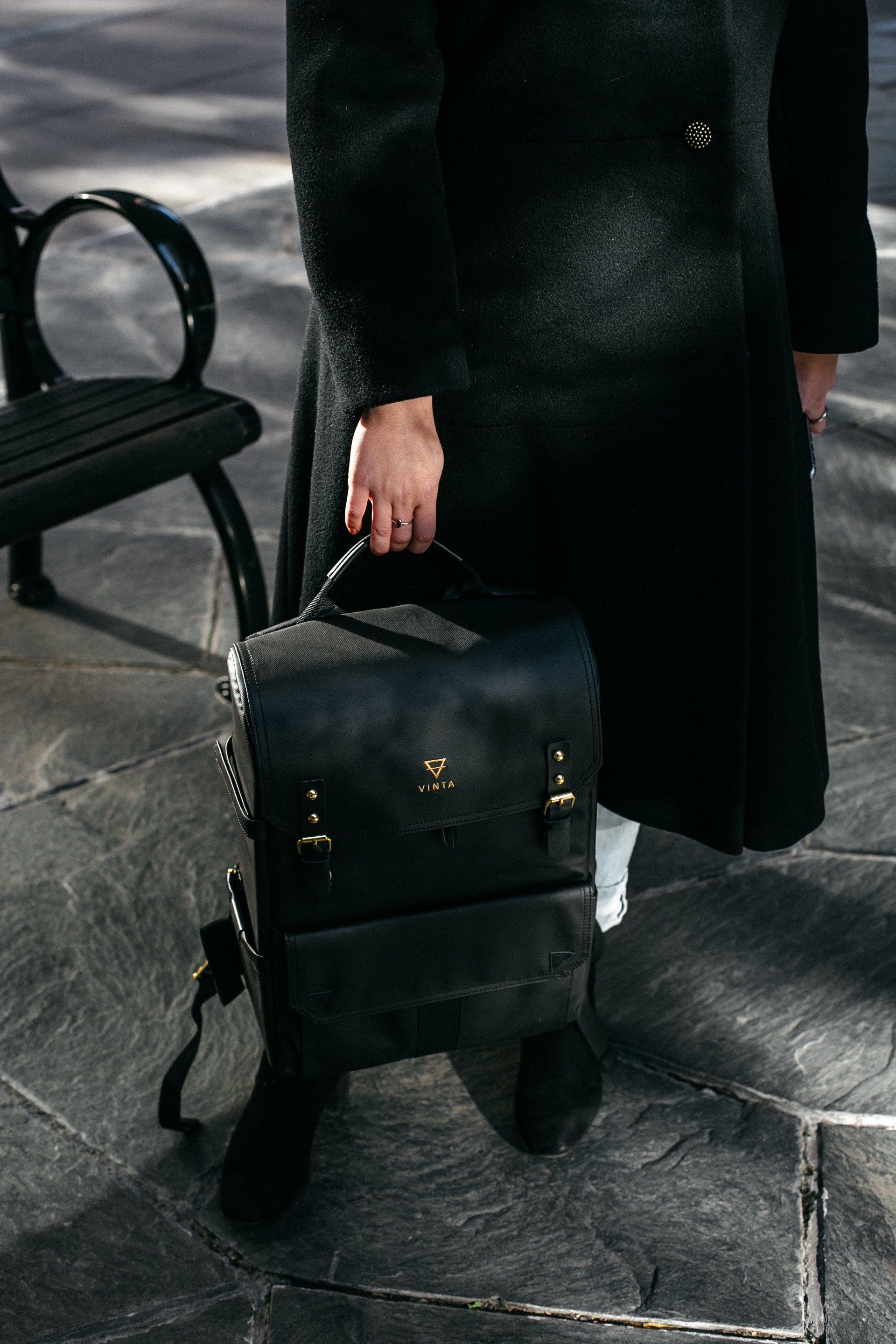 Person Holding Black Leather Backpack