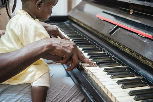 A Toddler Learning to Play Piano
