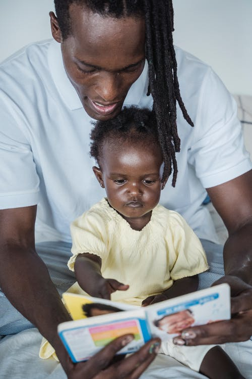 A Father Reading a Book to His Child