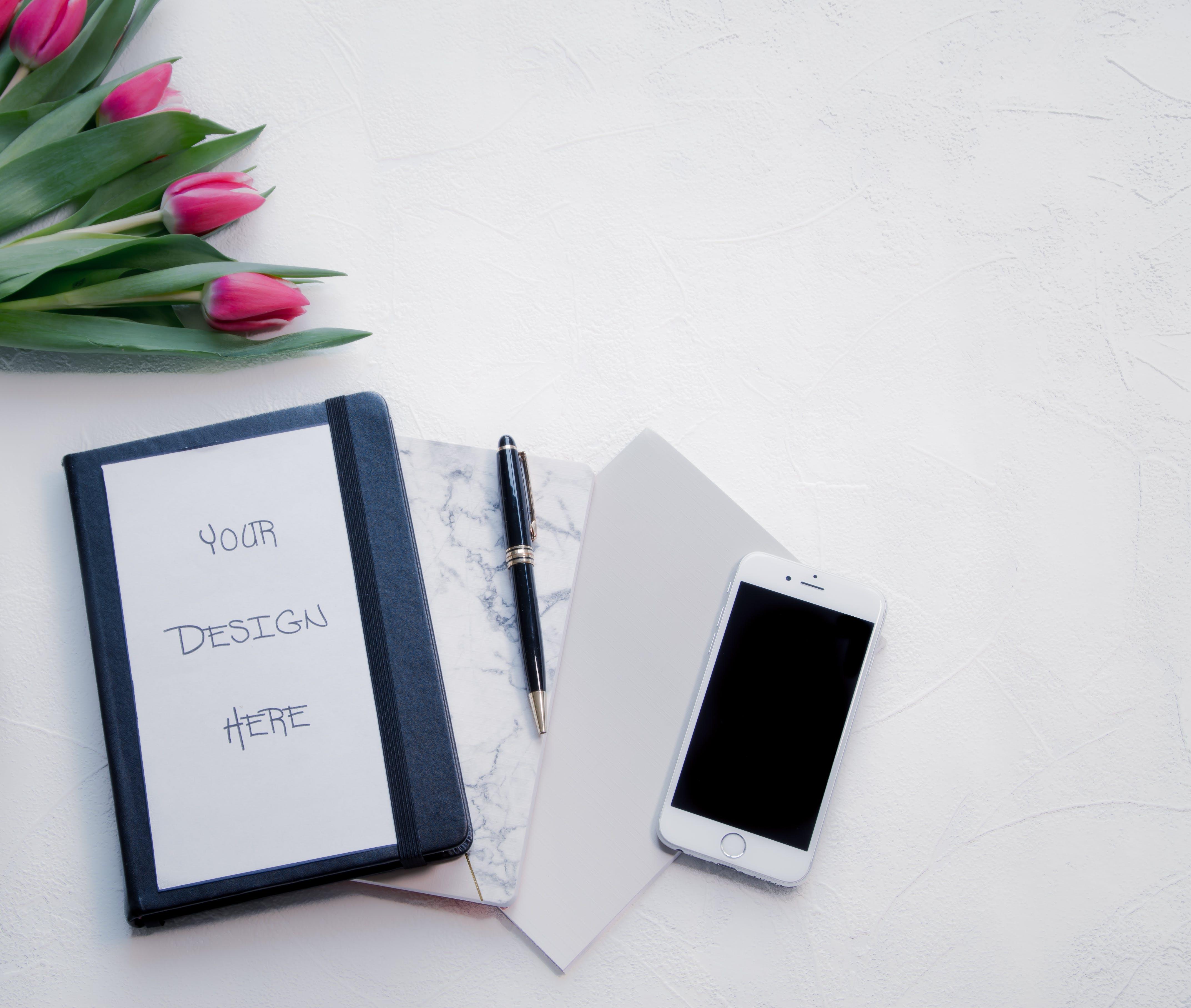 Silver Iphone 6 Beside Black Twist Pen