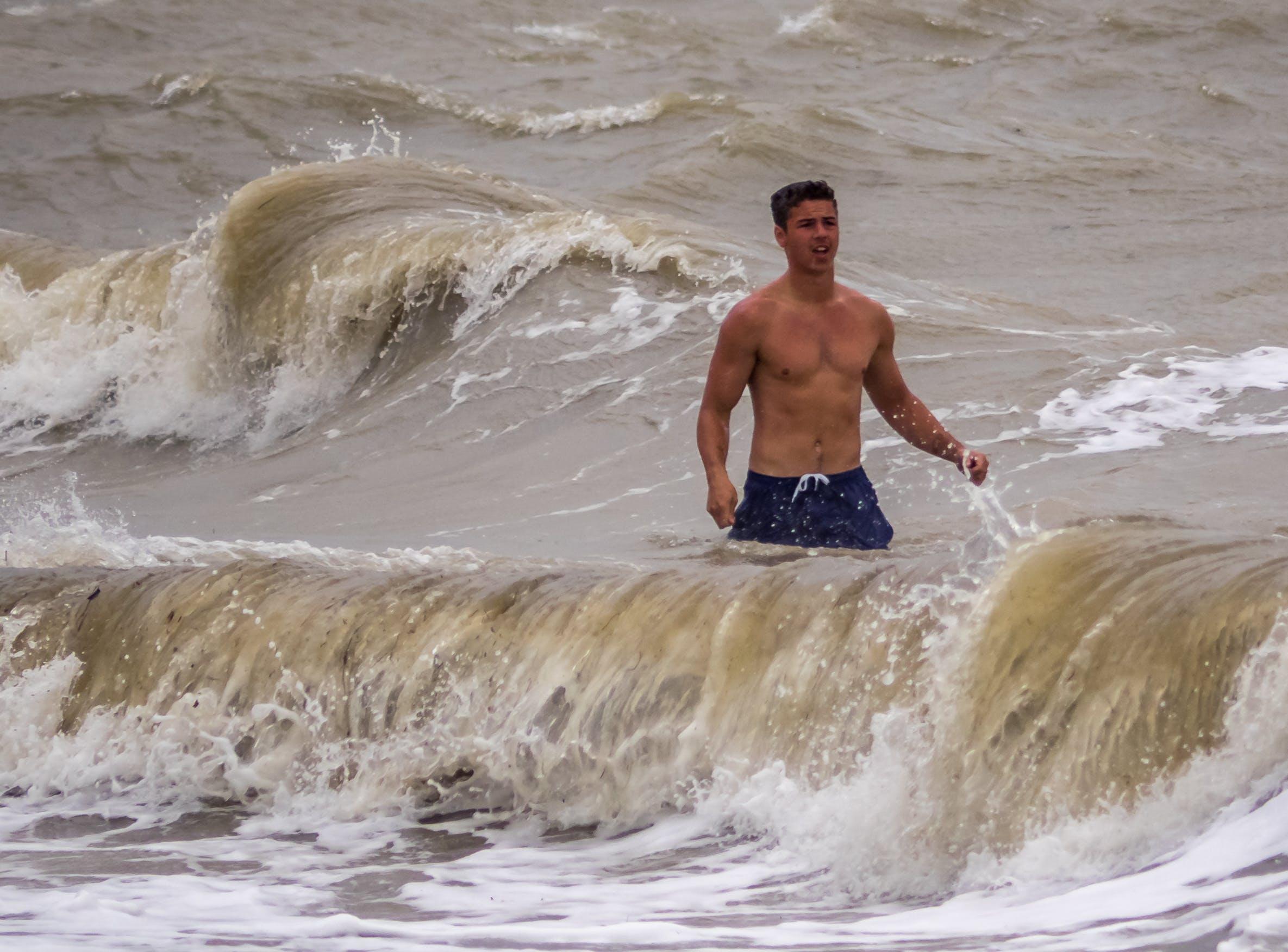 Free stock photo of male, sea, storm, swim