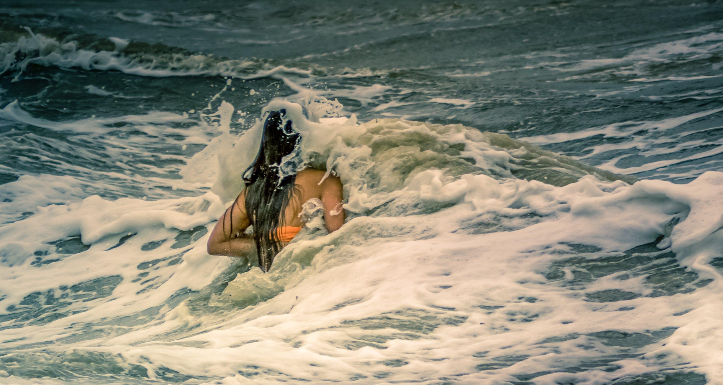 Free stock photo of female, sea, storm, swim