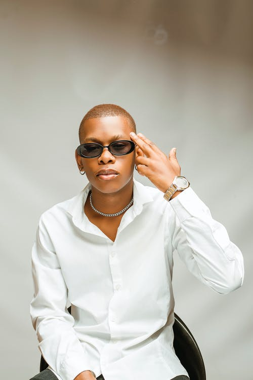 Woman in White Dress Shirt Wearing Black Sunglasses