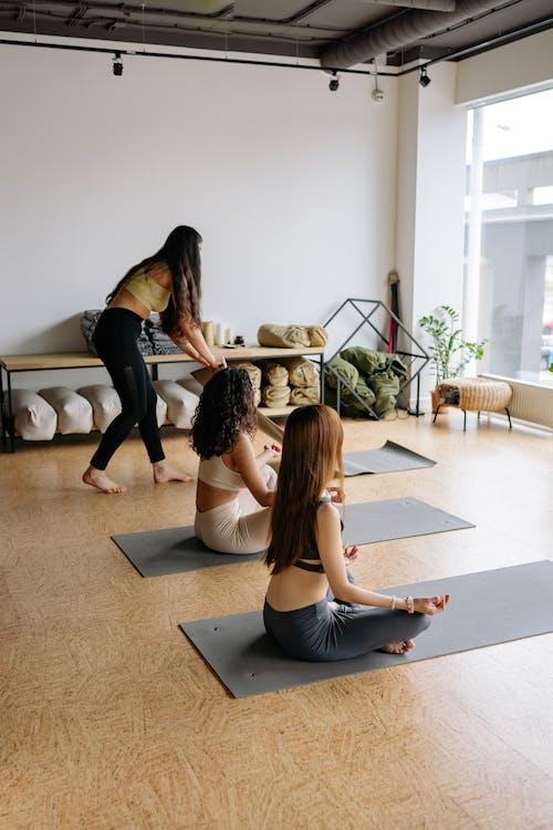 Women Meditating in a Yoga Class