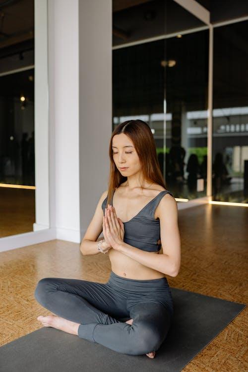 Woman in Activewear Meditating