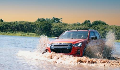 Red Honda Suv on Water