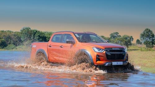Orange Chevrolet Crew Cab Pickup Truck on Water