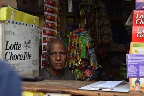 Free stock photo of man, shop, shopkeaper