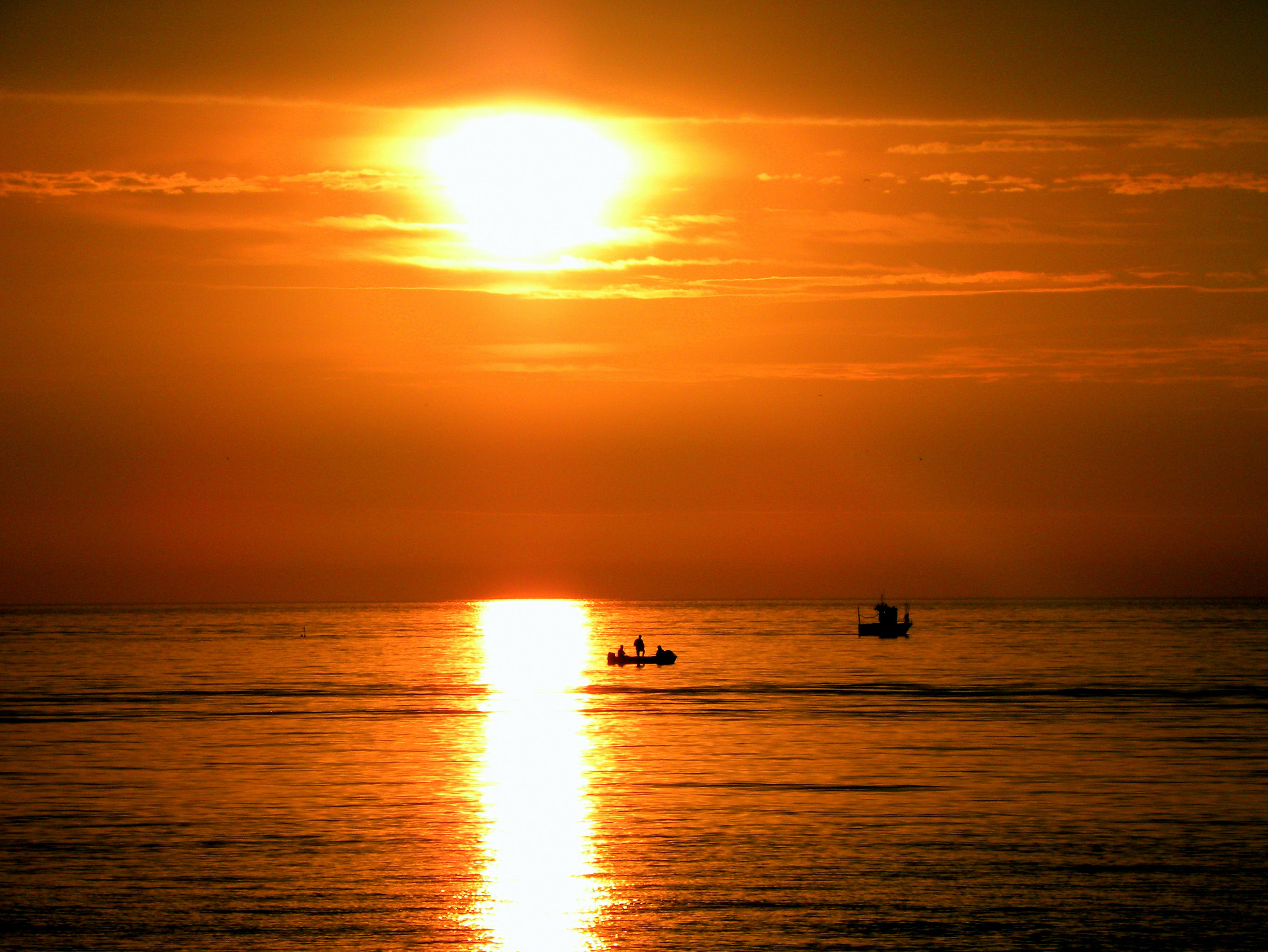 Silhouette of People on Boat during Golden Hours