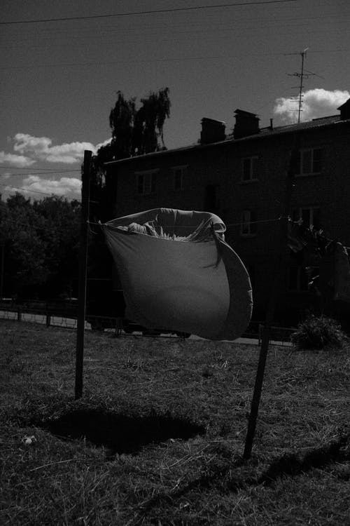 A Bedsheet Hanging in the Clothesline