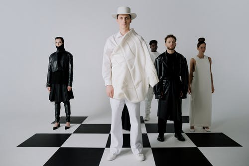 Man in White Blazer Standing Beside Man in Black Blazer