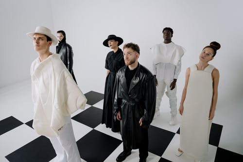 Group of People Standing on White Floor