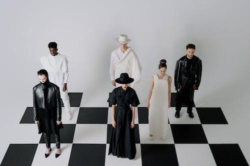 Woman in Black Dress Standing Beside Woman in White Dress