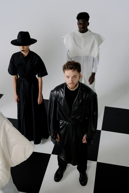 Man in Black Dress Shirt Standing Beside Man in Black Dress Shirt