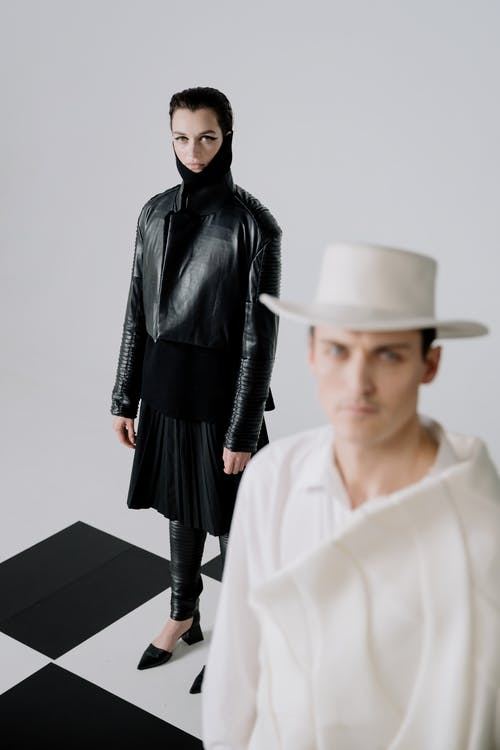 Woman in Black Leather Jacket and White Hat