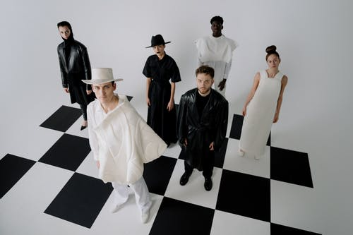 Group of People Standing on Black and White Checkered Floor