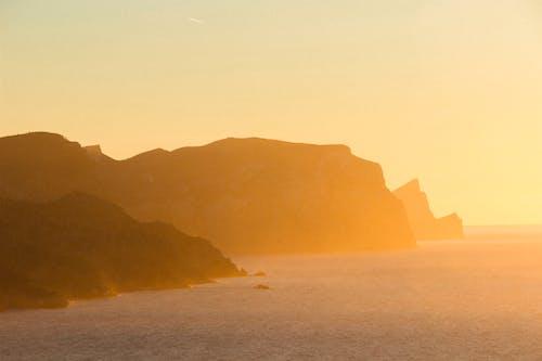 Free stock photo of mountains, orange, sea water