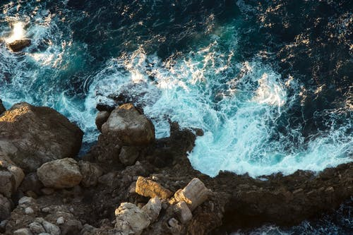 Free stock photo of aerial shot, blue water, stones