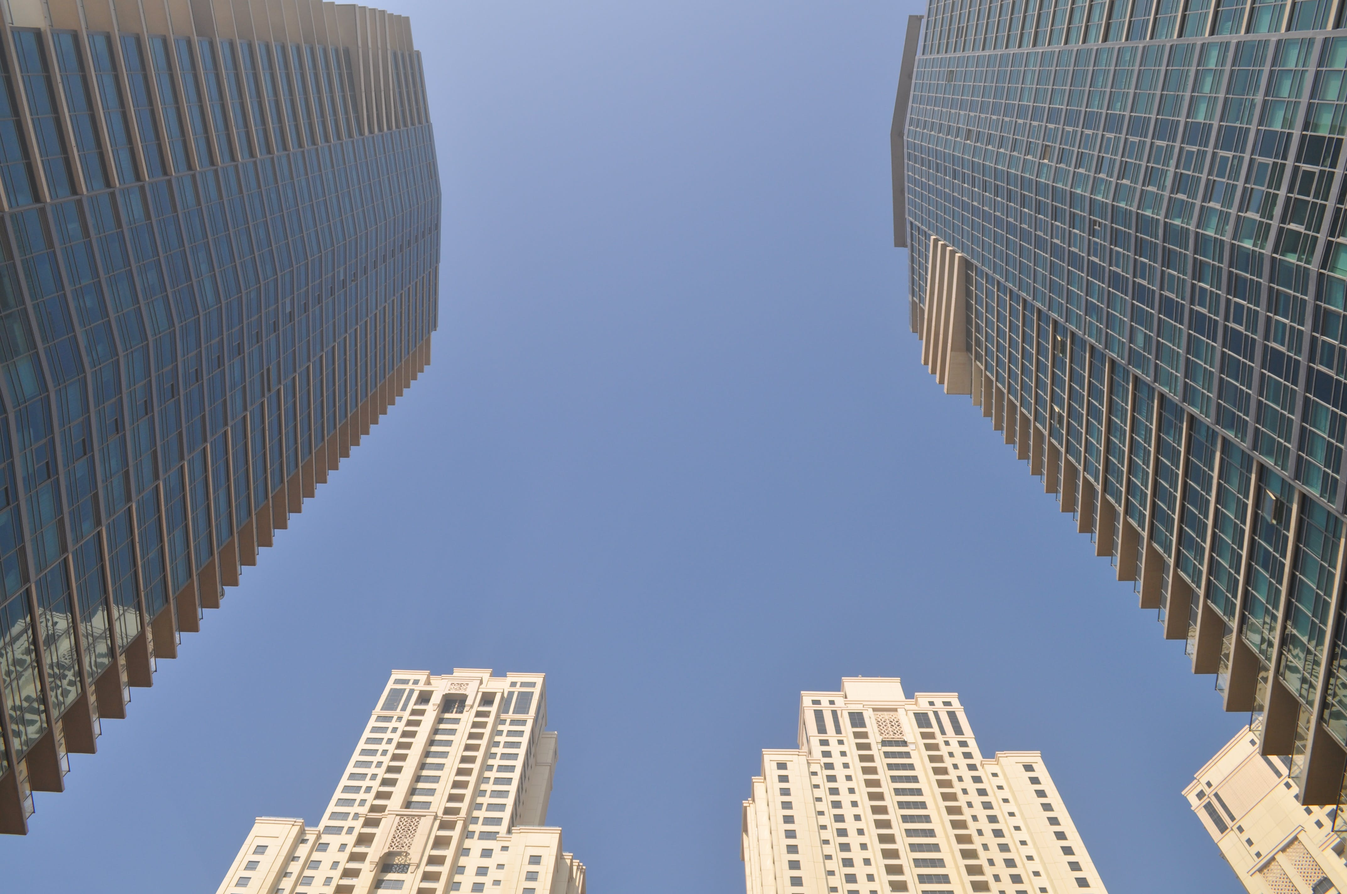 Two Gray-and-blue Glass Buildings