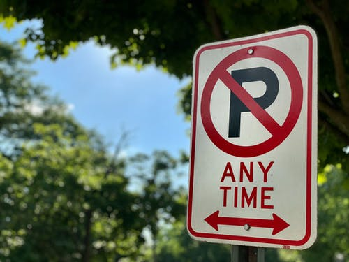 Selective Focus Photo of a No Parking Sign