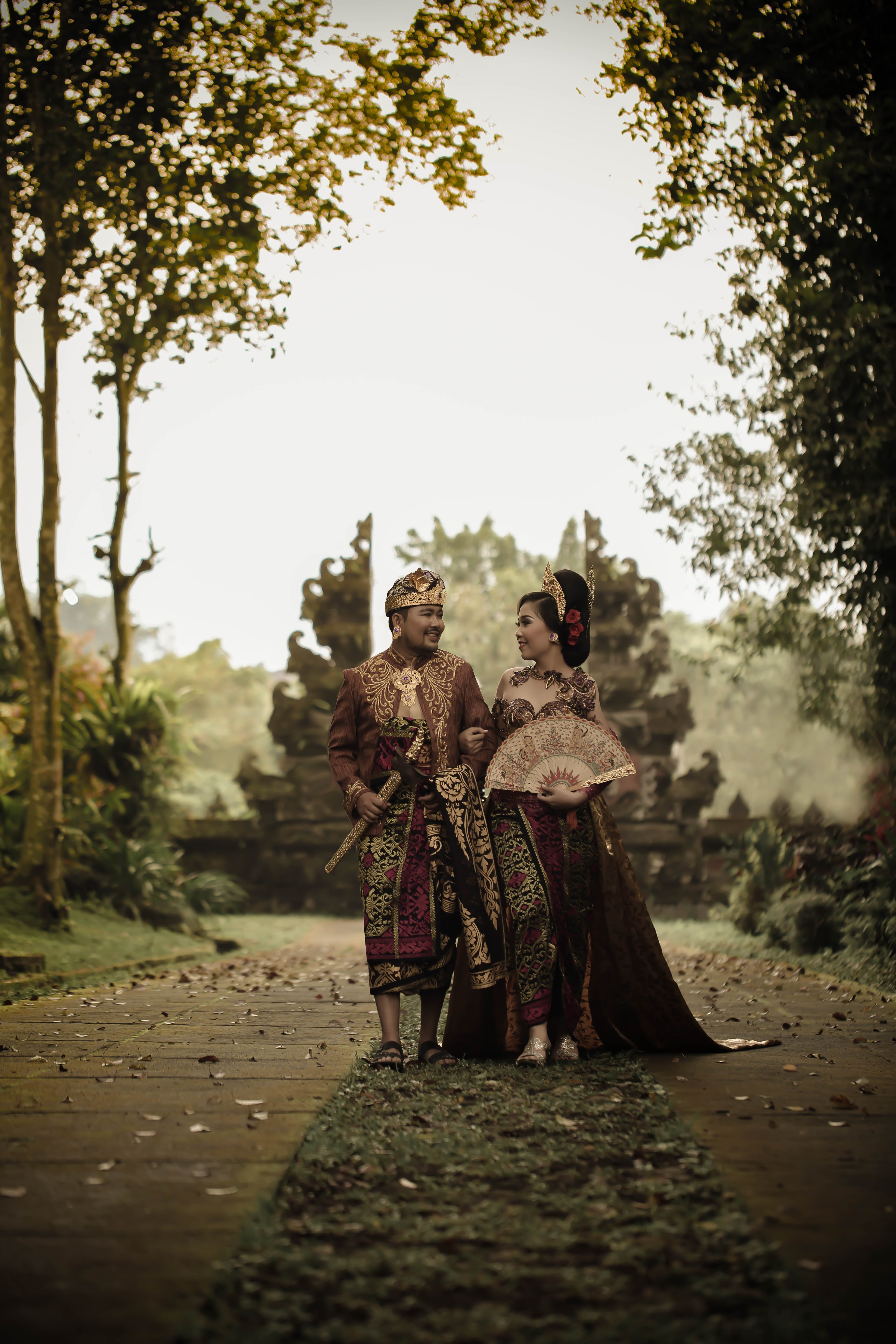 Man and Woman in Traditional Clothing Near Angkor Wat