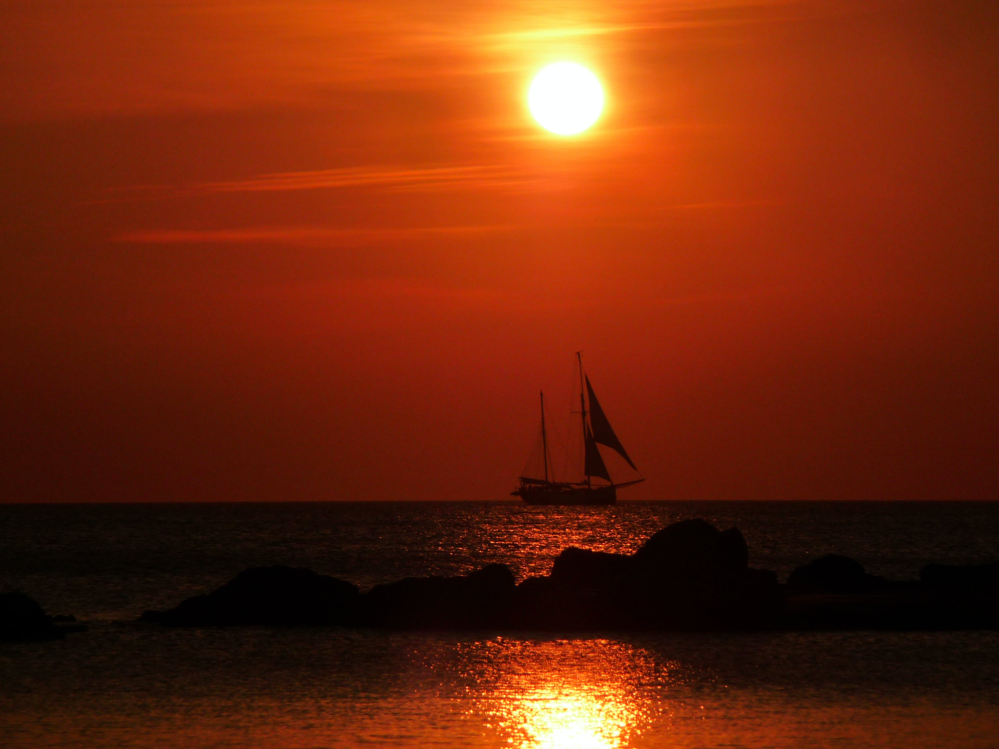 Sailboat on the Ocean during Sunset