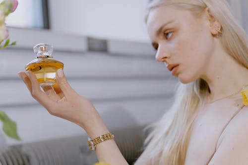 Woman Holding a Perfume